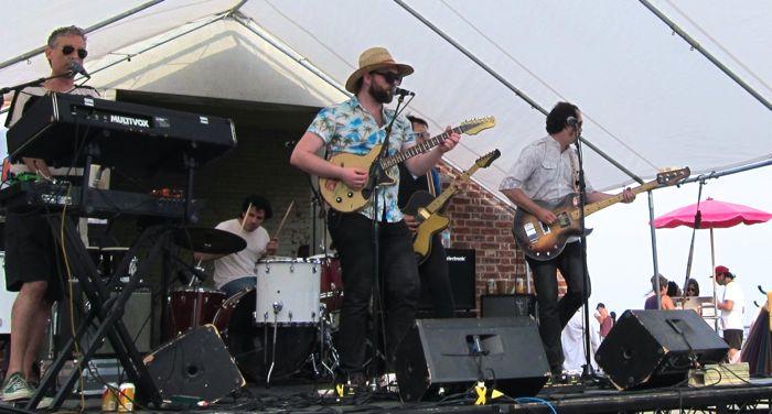 Caveman live by Liz Rowley